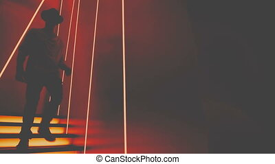 Man goes down the stairs in a nightclub