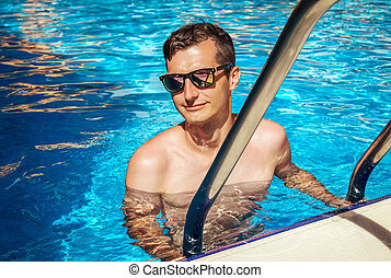 Man goes out of the swimming pool