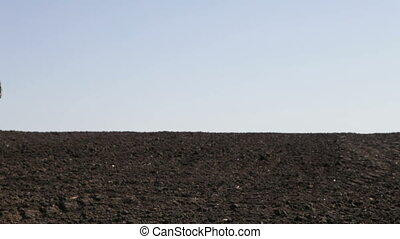 man goes to the plowed field - SMELA, CHERKASSKAYA/UKRAINE -...