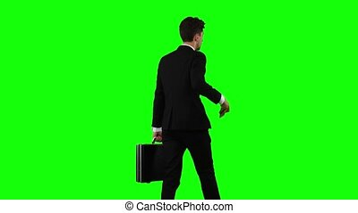 Man goes to work and talks on the phone. Green screen