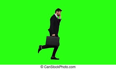 Man goes to work, understands that he is late and begins to run. Green screen. Slow motion