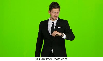 Man goes to work, with a diplomat he waves his hand to others. Green screen
