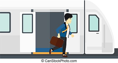 Man going out of train.