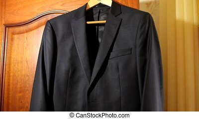 Man Going To A Wedding - The groom wears his wedding suit....