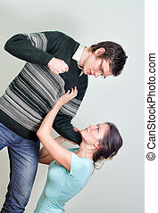 Man going to beat his wife. Home violence concept
