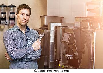 Man going to repare coffee machine