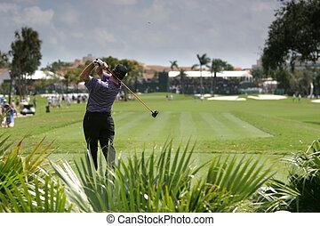 Man golf swing on a golf course