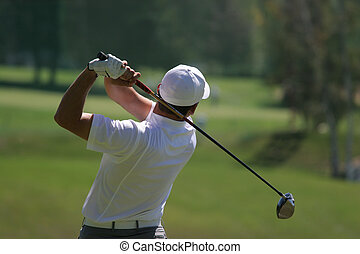 Man golf swing on a golf course