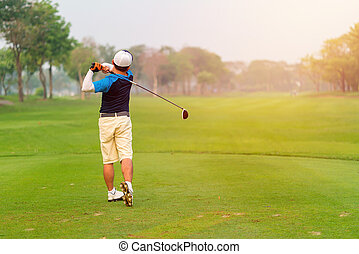 Man Golfer Hitting Ball with Club on Beatuiful Golf Course