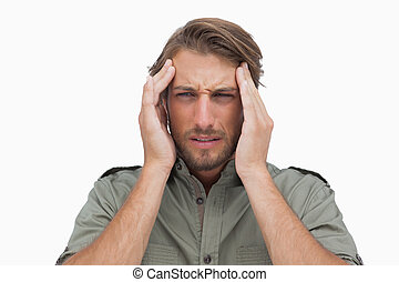 Man grimacing with pain of headache