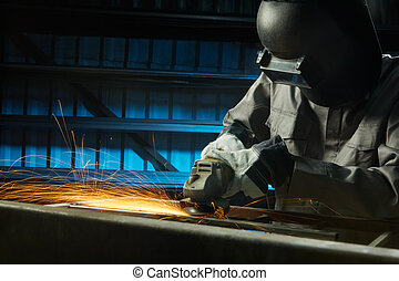 grinding - man grinding in workshop with safety precaution
