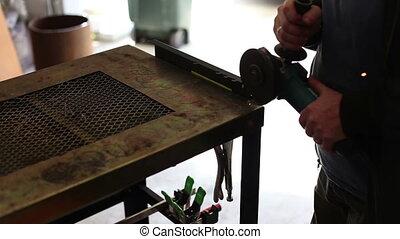 Man Grinding Off Metal in workshop