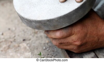 man grinds item from car HD