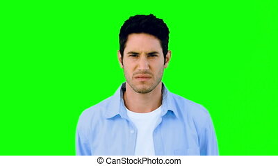 Man growling at camera angrily on green screen in slow...
