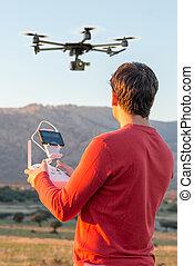Man guiding a drone