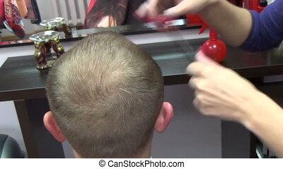 man hair trim - SIRVINTOS, LITHUANIA - SEPTEMBER 29:...
