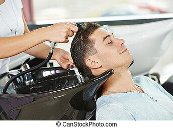 Man hair washing in hairdressing salon