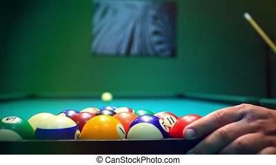 Man hand Alignment balls and taking away the triangle to start a game of billiards. HD. 1920x1080