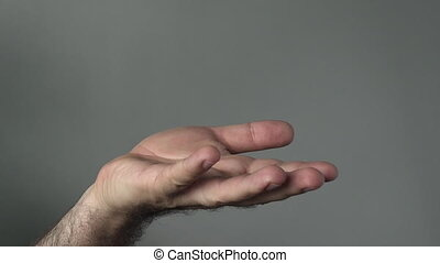 Man hand begging on a grey background. Concepts and ideas...