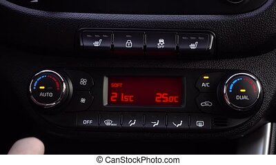 Man hand close up adjusts the temperature in the car. 4K.