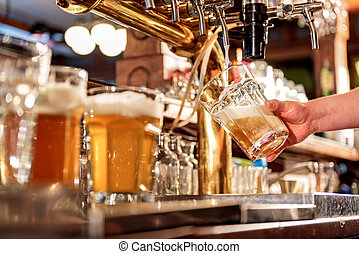 Man hand filling glass of alcohol beverage