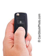Man hand holding a garage door remote control