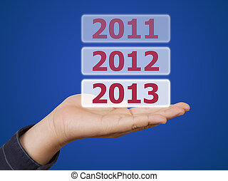 man hand holding button 2013 keyword