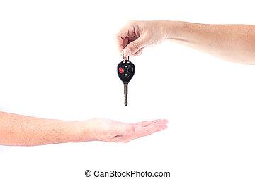Man hand holding car keys exchange isolated on white background