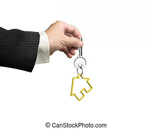 Man hand holding key with house shape keyring - Man hand...