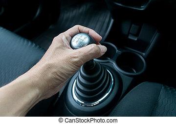 Man hand holding manual transmission
