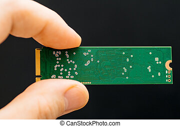 Man hand holding NVME PCIE SSD hard drive disk with high...