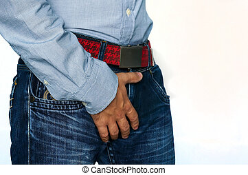 Man hand holding on middle crotch of trousers isolated on...