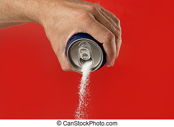 man hand holding refresh drink can pouring sugar stream in sweet and calories content of soda and energy drinks