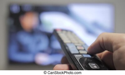 man hand holding the TV remote control and lifestyle turn...