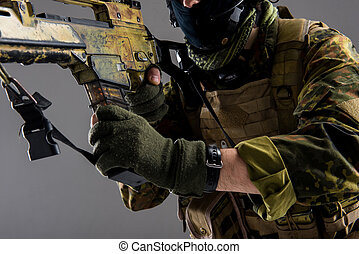 Man hand keeping assault rifle - Close up male arm taking...