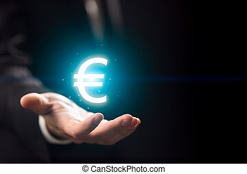 Man hand l with euro icon - Man hand holding blue crystal...