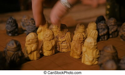 Man hand placing figures for medieval popular strategy board...