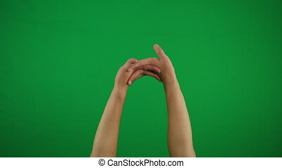 Man hand pointing at someone over yellow background 4k