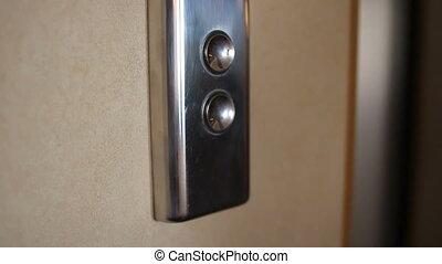 Man hand press the elevator button - Man pressing elevator...