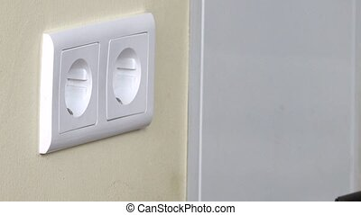 Man hand Put Plug Into Electricity Socket - Man Hand Putting...