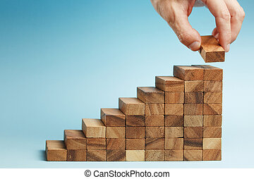 hand put wooden blocks arranging stacking for development as step stair