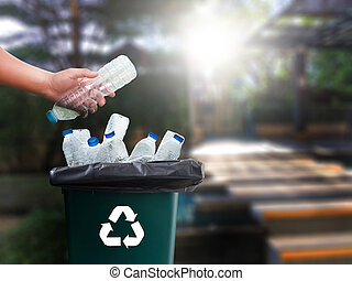man hand putting plastic reuse for recycling concept...