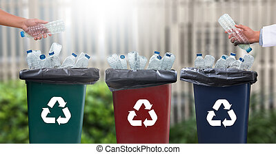 man hand putting plastic reuse for recycling concept ...