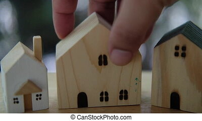 Man hand select wood home for the best home in my life. Concept of selection home