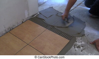 man hand spread cement - Man hand spreading adhesive...