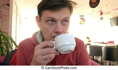 man hand stroking the cup of tea in cafe. man in restaurant...