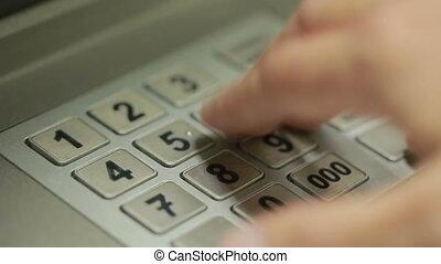 man hand touching ATM machine. gaining password. - Human...