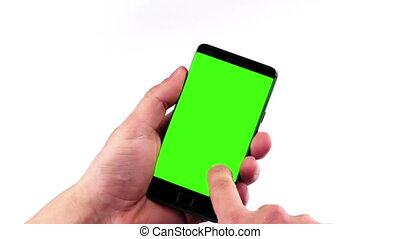 man hand using a smart phone with chroma key on white background, green screen, lifestyle communication with smartphone technology concept