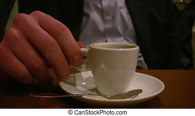 man hand with cup coffee