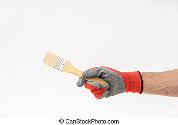 Man hand with red anti slip glove holding paint brush